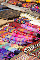 An arrangement of handmade textiles for sale at Chinchero Town Sunday Market, Cusco Region, Peru, South America
