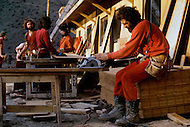 Wasco, Oregon, January 1984: Disciples of Bhagwan Rajneesh working on a construction of a hotel where visitors could stay. Since Rajneeshpuram was established, around 60,000 visitors came every year to take part in the community celebrations. Rajneeshpuram, was an intentional community in Wasco County, Oregon, briefly incorporated as a city in the 1980s, which was populated with followers of the spiritual teacher Osho, then known as Bhagwan Shree Rajneesh. The community was developed by turning a ranch from an empty rural property into a city complete with typical urban infrastructure, with population of about 7000 followers.