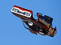 Mar. 7, 2009; Bakersfield, CA, USA; The body from the car driven by nostalgia funny car driver Tom Padilla flies through the air after blowing off from an explosion during qualifying for the 51th annual March Meet at the Auto Club Famoso Raceway. Mandatory Credit: Mark J. Rebilas-