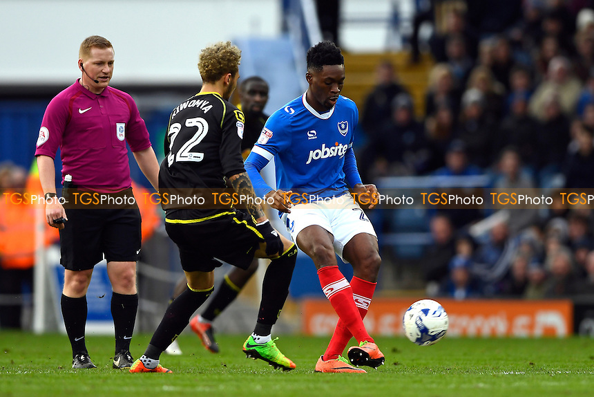 Amine Linganzi of Portsmouth plays a pass under pressure from Alex Kiwomya of Crewe Alexandra during Portsmouth vs Crewe Alexandra, Sky Bet EFL League 2 Football at Fratton Park on 4th March 2017
