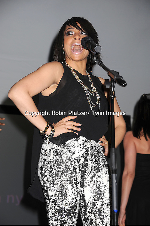 """Raven -Symone singing at the  """"Made in NY""""  Awards at Gracie Mansion on June 4, 2012 in New York City."""
