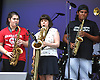 Natalie Barbieri of East Northport, left, and George Ariza of Island Park jam on alto saxophone with baritone saxophonist Sarah Turkiew of Bethpage during the third annual Coltrane Music Festival at Hecksher Park in Huntington on Saturday, July 22, 2017.