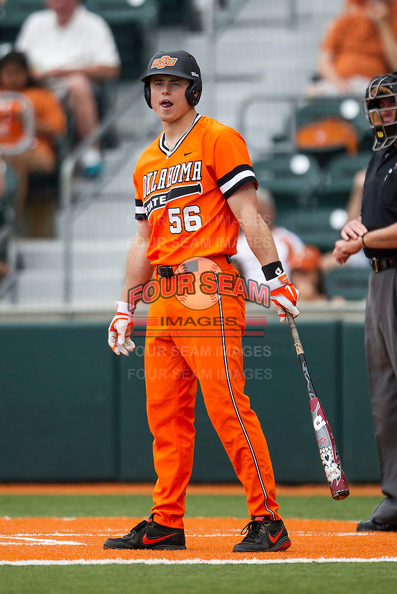 Oklahoma State Cowboys outfielder Ryan Sluder #56 looks to his coach for the sign during the NCAA baseball game against the Texas Longhorns on April 26, 2014 at UFCU Disch–Falk Field in Austin, Texas. The Cowboys defeated the Longhorns 2-1. (Andrew Woolley/Four Seam Images)
