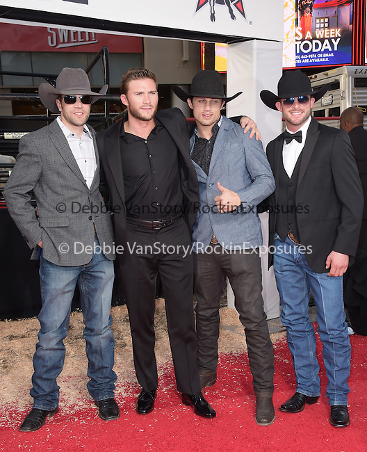 Scott Eastwood and some bull riders at The Twentieth Century Fox  premiere of THE LONGEST RIDE held at the TCL Chinese Theatre  in Hollywood, California on April 06,2015                                                                               © 2015 Hollywood Press Agency