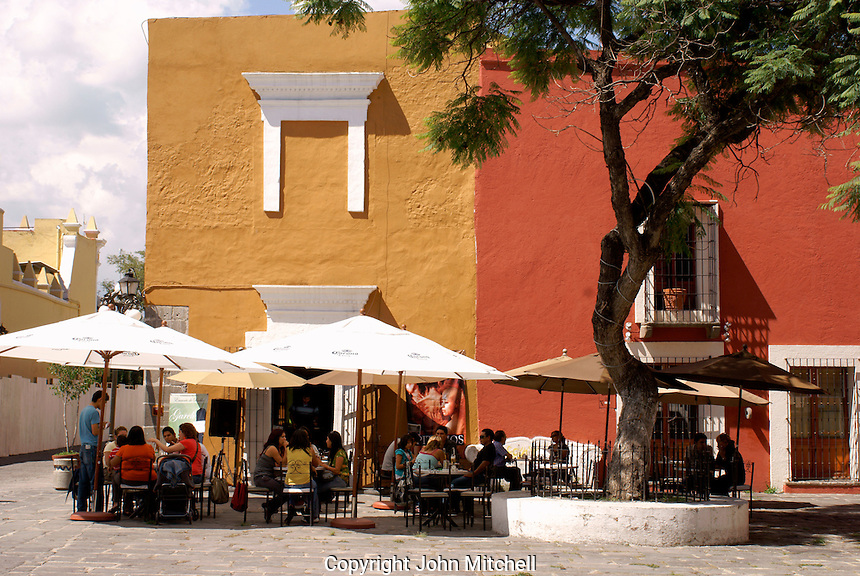 People in an outdoor cafe  in the Barrio del Artista  in the city of Puebla, Mexico