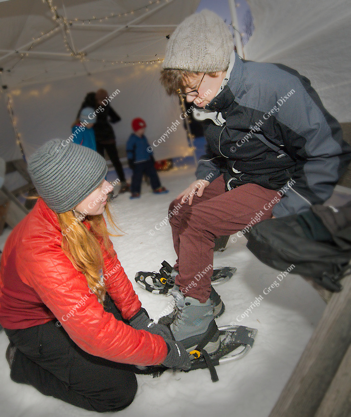 People enjoy the Candlelit Snowshoe Hike at Aldo Leopold Nature Center on Saturday in Madison