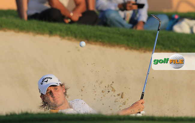 Emiliano Grillo (ARG) playing out of a bunker onto the 18th green during Round 3 of the DP World Tour Championship at the Earth course,  Jumeirah Golf Estates in Dubai, UAE,  21/11/2015.<br /> Picture: Golffile | Thos Caffrey<br /> <br /> All photo usage must carry mandatory copyright credit (&copy; Golffile | Thos Caffrey)