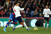 23rd November 2019; Selhurst Park, London, England; English Premier League Football, Crystal Palace versus Liverpool; Virgil van Dijk of Liverpool competes for the ball with Jordan Ayew of Crystal Palace in the box as Liverpool will score from the rebound - Strictly Editorial Use Only. No use with unauthorized audio, video, data, fixture lists, club/league logos or 'live' services. Online in-match use limited to 120 images, no video emulation. No use in betting, games or single club/league/player publications