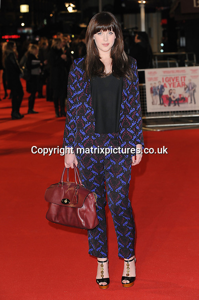 "NON EXCLUSIVE PICTURE: PAUL TREADWAY / MATRIXPICTURES.CO.UK.PLEASE CREDIT ALL USES..WORLD RIGHTS..Welsh actress Alexandra Roach (wearing purple and black trouser suit with Mulberry handbag) attending the UK film premiere of ""I Give It A Year"", at London's Odeon West End...JANUARY 24th 2013..REF: PTY 13491"