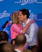 Ann Romney, left, hugs her youngest son, Craig, right, after his introduction of her at the Latino Coalition Luncheon during the 2012 Republican National Convention in Tampa Bay, Florida on Tuesday, August 28, 2012.  .Credit: Ron Sachs / CNP.(RESTRICTION: NO New York or New Jersey Newspapers or newspapers within a 75 mile radius of New York City)