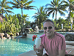 "Guy relaxing poolside at the Intercontinental Beachcomber ""Moana"" Resort on the beautiful island of Bora Bora."