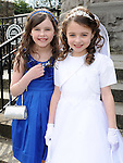 Kate Dennis from Scoil Mhuire Fatima who made her First Holy Communion in St Mary's church pictured with her sister Emily. Photo: Colin Bell/pressphotos.ie