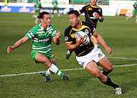 Wellington winger Alapati Leiua tries to get around Aaron Cruden during the Air NZ Cup preseason match between Manawatu Turbos and Wellington Lions at FMG Stadium, Palmerston North, New Zealand on Friday, 17 July 2009. Photo: Dave Lintott / lintottphoto.co.nz