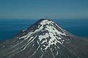 July 17 thru 23 / Alaska / Vacation and stock photography / Iliamna Volcano shows small amount of smoke coming from peak in South West Alaska at Katmai Penninsula / Photo by Bob Laramie