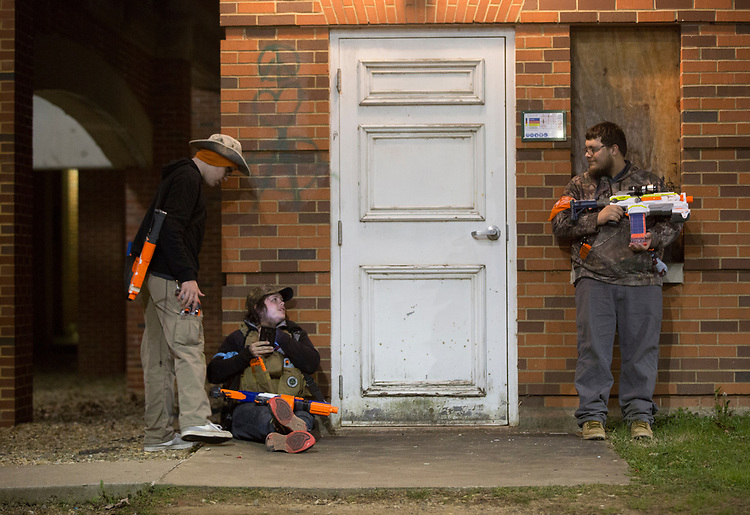 From left to right, Justin Mooney, Cody Parker, and Jon Byers talk about the night's Humans vs. Zombies mission on March 23, 2017.