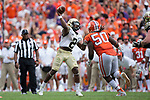 Kendall Hinton (2) of the Wake Forest Demon Deacons throws a touchdown pass during fourth quarter action against the Clemson Tigers at Memorial Stadium on October 7, 2017 in Clemson, South Carolina.  The Tigers defeated the Demon Deacons 28-14. (Brian Westerholt/Sports On Film)