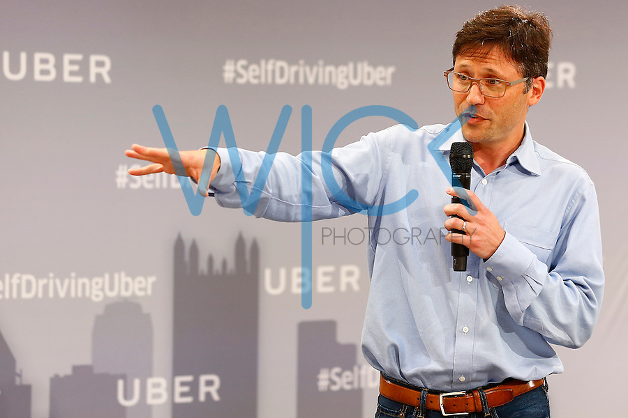 Eric Meyhofer, Engineering Lead at Uber ATC, speaks to the media on Tuesday, September 13, 2016 in Pittsburgh, Pennsylvania. (Photo by Jared Wickerham/Wick Photography)