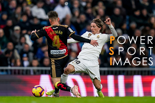 Luka Modric of Real Madrid (R) fights for the ball with Alvaro Medran of Rayo Vallecano during the La Liga 2018-19 match between Real Madrid and Rayo Vallencano at Estadio Santiago Bernabeu on December 15 2018 in Madrid, Spain. Photo by Diego Souto / Power Sport Images