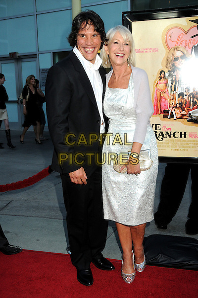 "SERGIO PERIS-MENCHETA & DAME HELEN MIRREN .""Love Ranch"" Los Angeles Premiere held at Arclight Cinemas, Hollywood, California, USA, 23rd June 2010..arrivals full length black suit jacket white shirt silver dress  cardigan shrug peep toe shoes sequined sequin clutch bag gold .CAP/ADM/BP.©Byron Purvis/AdMedia/Capital Pictures."