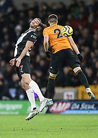 Newcastle United's Andy Carroll heads the ball under pressure from Wolverhampton Wanderers' Matt Doherty<br /> Photographer Lee Parker/CameraSport<br /> <br /> The Premier League - Wolverhampton Wanderers v Newcastle United - Saturday 11th January 2020 - Molineux - Wolverhampton<br /> <br /> World Copyright © 2020 CameraSport. All rights reserved. 43 Linden Ave. Countesthorpe. Leicester. England. LE8 5PG - Tel: +44 (0) 116 277 4147 - admin@camerasport.com - www.camerasport.com