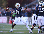 Nevada's Cody Fajardo looks to throw in the first half of an NCAA college football game against UNLV in Reno, Nev., on Saturday, Oct. 26, 2013.<br /> Photo by Cathleen Allison