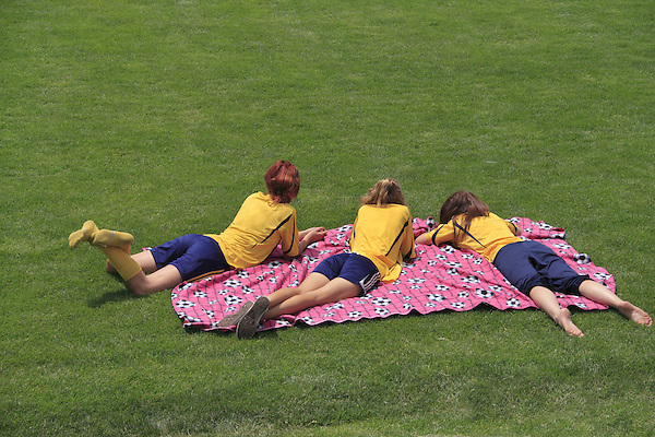 Girls resting on blanket after soccer game, Denver, Colorado, USA. .  John leads private photo tours in Boulder and throughout Colorado. Year-round. .  John offers private photo tours in Denver, Boulder and throughout Colorado. Year-round.