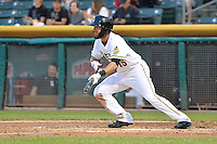 Matt Long (15) of the Salt Lake Bees squares to bunt against the Reno Aces at Smith's Ballpark on May 4, 2014 in Salt Lake City, Utah.  (Stephen Smith/Four Seam Images)