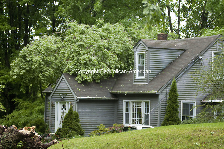 TORRINGTON, CT - 28 MAY 2014 --  A tree fell on this house on Baker Road in Roxbury during a thunderstorm Tuesday. Alec Johnson/ Republican-American