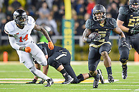 Baylor running back Johnny Jefferson (2) is chased by Oklahoma State linebacker Josh Furman (14) during second half of an NCAA football game, Saturday, November 22, 2014 in Waco, Tex. Baylor defeated Oklahoma State 49-28. (Mo Khursheed/TFV Media via AP Images)