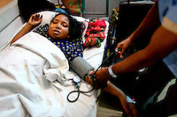 A factory worker receives treatment in hospital after being injured during the blaze. At least 112 people died, and more than 100 were injured at a fire at the Tazreen Fashions textile factory in Dhaka. Bangladesh's garment industry has a notoriously bad fire safety record; if the right precautions had been taken, the fire could have been prevented.