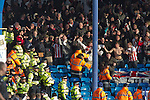 "Portsmouth 1 Southampton 1, 18/12/2012. Fratton Park, Championship. Stewards trying to restrain vising Southampton fans as they react with delight as their team take the lead during the second half of their Championship fixture against Portsmouth at Fratton Park stadium. Around 3000 away fans were taken directly to the game in a fleet of buses in a police operation known as the ""coach bubble"" to avoid the possibility of disorder between rival fans. The match ended in a one-all draw watched by a near capacity crowd of 19,879. Photo by Colin McPherson."