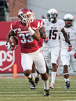 STAFF PHOTO ANTHONY REYES • @NWATONYR<br /> Arkansas Kroliss Marshall runs the opening kickoff against Northern Illinois University for a touchdown Saturday, Sept. 20, 2014 at Razorback Stadium in Fayetteville.