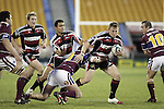 Nigel Watson is taken by Jeff Wright during the Air NZ Cup game between the Counties Manukau Steelers and Southland played at Mt Smart Stadium on 3rd September 2006. Counties Manukau won 29 - 8.