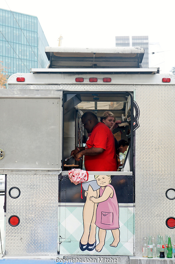 Black man cooking in a food truck, Vancouver, British Columbia, Canada