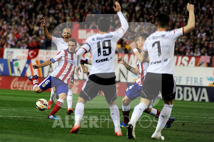 Atletico de Madrid´s Koke shoots to goal and Valencia CF´s Antonio Barragan and Alvaro Negredo during 2014-15 La Liga match between Atletico de Madrid and Valencia CF at Vicente Calderon stadium in Madrid, Spain. March 08, 2015. (ALTERPHOTOS/Luis Fernandez)