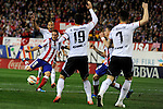 Atletico de Madrid´s Koke shoots to goal and Valencia CF´s Antonio Barragan and Alvaro Negredo during 2014-15 La Liga match between Atletico de Madrid and Valencia CF at Vicente Calderon stadium in Madrid, Spain. March 08, 2015. (ALTERPHOTOS/Luis Fernandez)