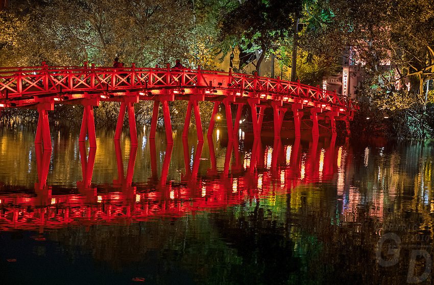 """Hoan Kiem Lake (Vietnamese: Hồ Hoàn Kiếm, meaning """"Lake of the Returned Sword"""" or """"Lake of the Restored Sword""""), also known as Hồ Gươm (Sword Lake), is a lake in the historical center of Hanoi, the capital ... to the shore by the wooden red-painted The Huc Bridge (The Huc, meaning Morning Sunlight Bridge).<br />  Hanoi, the capital of Vietnam, is known for its centuries-old architecture and a rich culture with Southeast Asian, Chinese and French influences. At its heart is the chaotic Old Quarter, where the narrow streets are roughly arranged by trade. There are many little temples, including Bach Ma, honoring a legendary horse, plus Đồng Xuân Market, selling household goods and street food."""