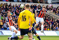 Luton Town defender Glenn Rea heads the ball back into the Oxford half during the Sky Bet League 2 match between Oxford United and Luton Town at the Kassam Stadium, Oxford, England on 16 April 2016. Photo by Liam Smith.