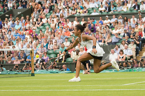 29.06.2012  The All England Lawn Tennis and Croquet Club. London, England. Heather Watson of Great Britain in action against Agnieszka Radwanska of Poland during third round at Wimbledon Tennis Championships at The All England Lawn Tennis and Croquet Club. London, England, UK