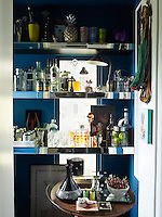 A drinks cabinet takes advantage of a small space off the staircase