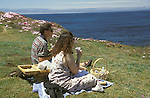 A couple enjoying a picnic lunch on the headlands of the Mendocino Botanical Gardens, Fort Bragg California