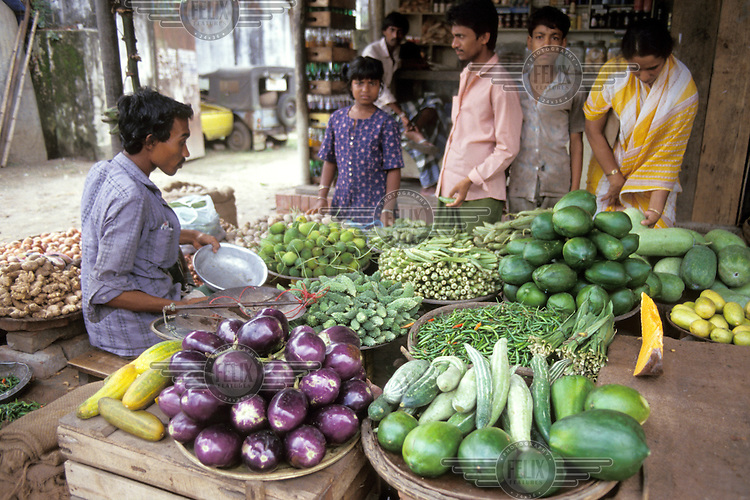 Market stall selling vegetables.