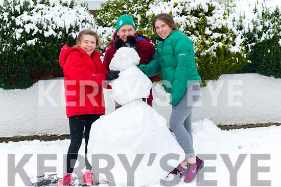 Abbie, Fergus and Holly Ring from Park Drive, Killarney making a snowman last Friday.