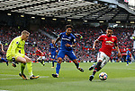 Jordan Pickford of Everton is drawn off his line by Jesse Lingard of Manchester United during the premier league match at the Old Trafford Stadium, Manchester. Picture date 17th September 2017. Picture credit should read: Simon Bellis/Sportimage