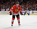 JONATHAN TOEWS,  of the Chicago Blackhawks in action  during the Blackhawks game against the Calgary Flames at the United Center in Chicago, IL.  The Chicago Blackhawks beat the Calgary Flames 4-2 in Chicago, Illinois on December 5, 2011....