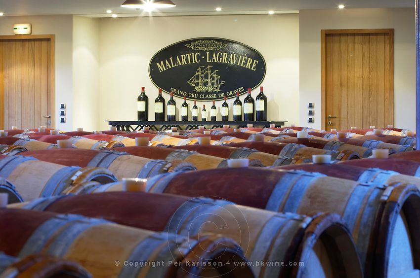 Oak barrel aging and fermentation cellar. Chateau Malartic Lagraviere, Pessac Leognan, Graves, Bordeaux, France