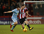 Billy Jones of Sunderland tackles Chris Basham of Sheffield Utd during the Championship match at Bramall Lane Stadium, Sheffield. Picture date 26th December 2017. Picture credit should read: Simon Bellis/Sportimage