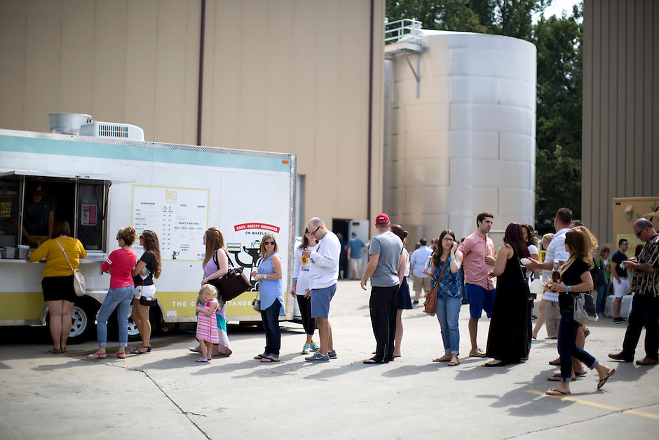 People wait in line at the Big Cheeze Food Truck during Oliver Winery's Harvest Wine Festival on Saturday, Sept.. 25, 2014. (Photo by James Brosher)