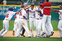 Buffalo Bisons outfielder Dalton Pompey (37) celebrates a walk off hit with Munenori Kawasaki (66), Caleb Gindl (15), Sean Ochinko (9) Matt Hague (16) and other teammates during a game against the Columbus Clippers on July 19, 2015 at Coca-Cola Field in Buffalo, New York.  Buffalo defeated Columbus 4-3 in twelve innings.  (Mike Janes/Four Seam Images)