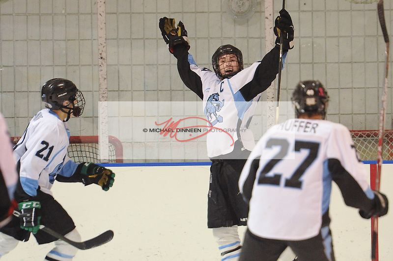 Chugiak's John Hammer celebrates his third-period goal as teammates Zach Krajnik and Tyler Huffer arrive during their CIC championship game Friday, Feb. 4, 2017.  Photo for the Star by Michael Dinneen